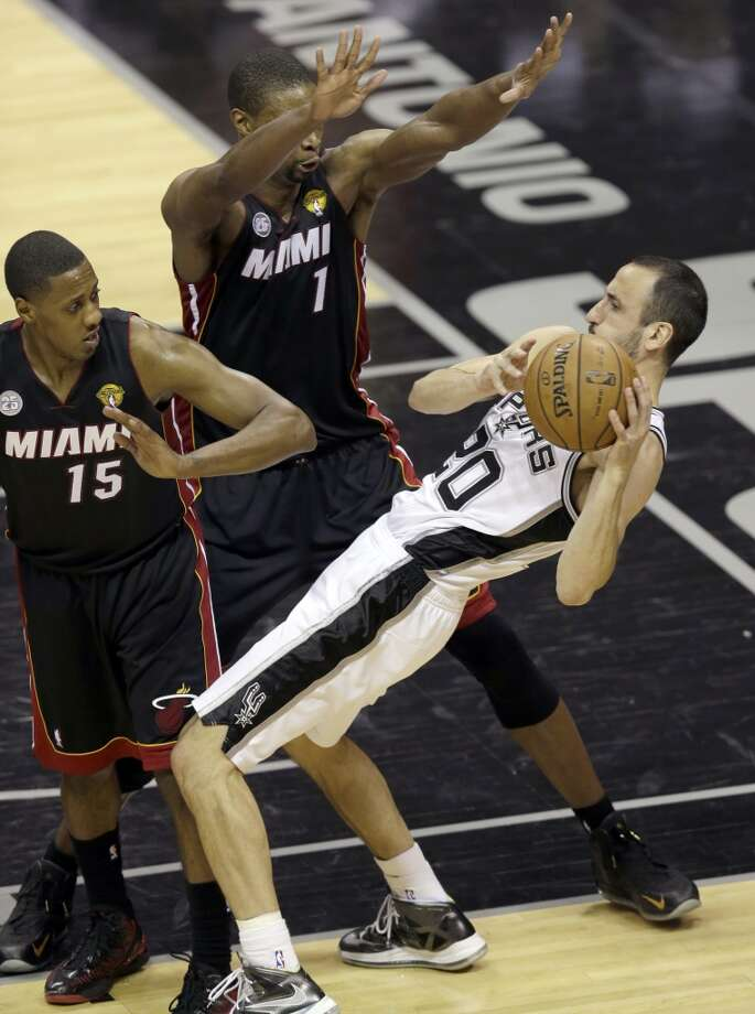 Manu Ginobili is defended by Mario Chalmers and Chris Bosh.