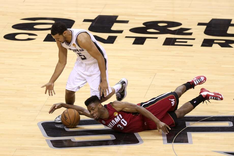 Cory Joseph and Norris Cole go after a loose ball.