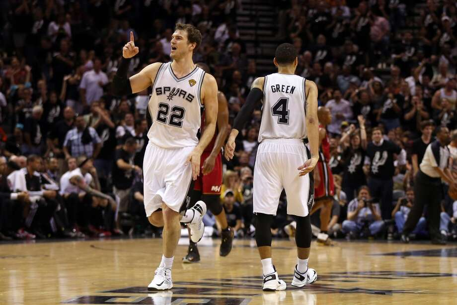 Tiago Splitter #22 of the Spurs celebrates in the fourth quarter.