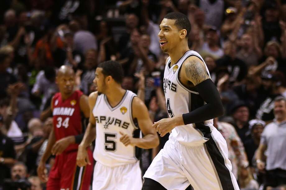 Danny Green #4 of the Spurs reacts after making a three-pointer in the fourth quarter.
