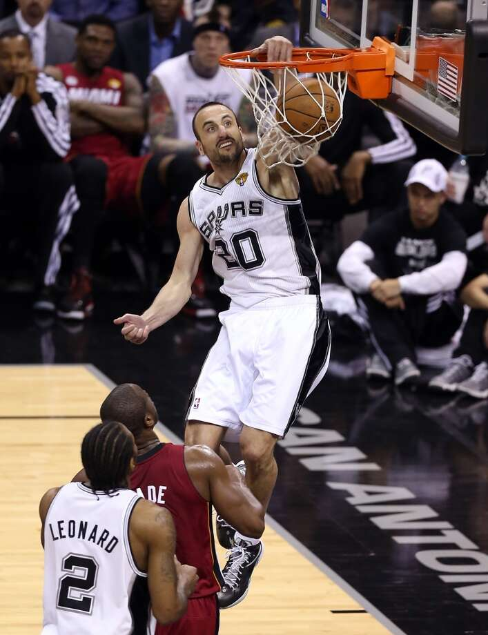 Manu Ginobili #20 of the Spurs dunks the ball in the second half.