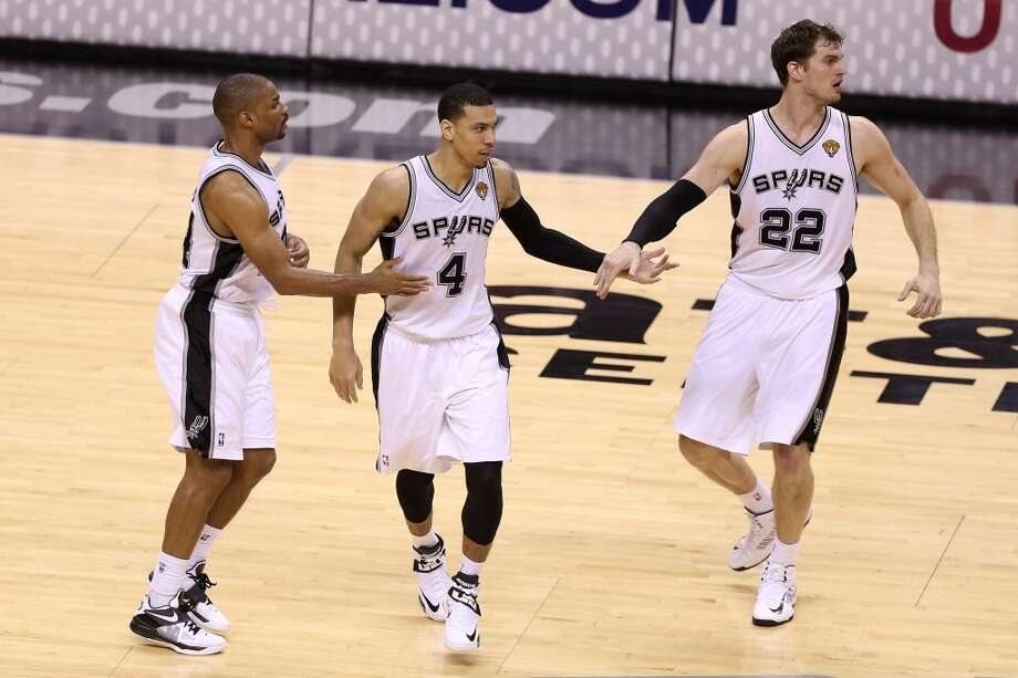Gary Neal #14, Danny Green #4 and Tiago Splitter #22 of the Spurs celebreate in the fourth quarter.