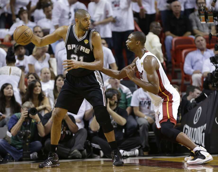 Tim Duncan of the Spurs posts up Chris Bosh during Game 2.