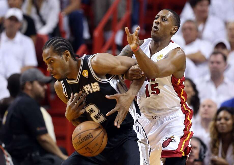 Kawhi Leonard of the Spurs is defended by Heat point guard Mario Chalmers during Game 2.