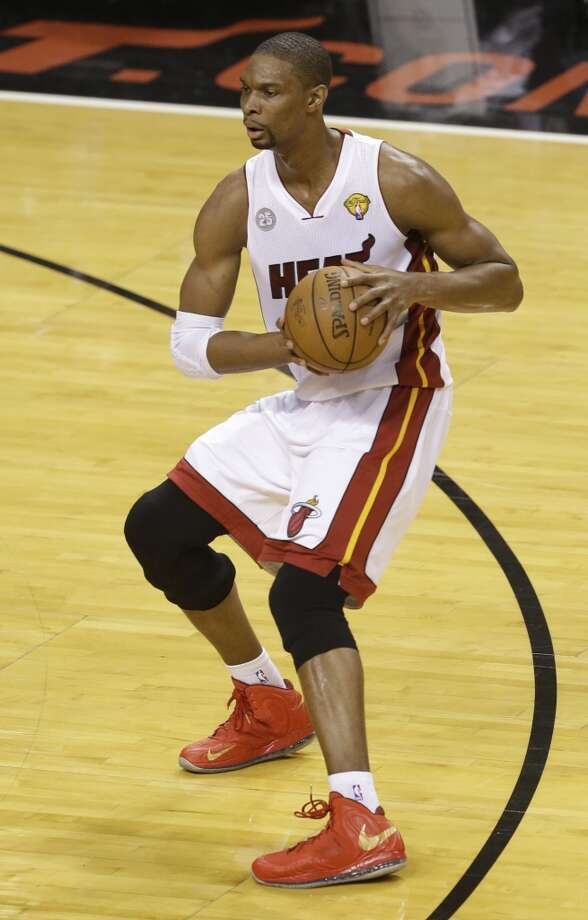 Heat forward Chris Bosh looks to pass off the ball during the first half.