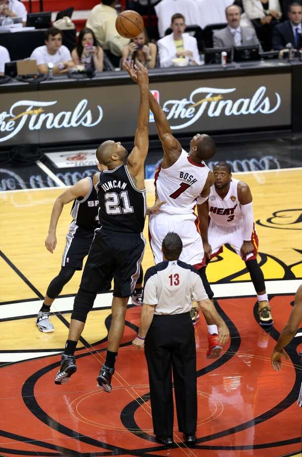 Heat forward Chris Bosh and Spurs forward Tim Duncan fight for the first jump ball of the NBA Finals.