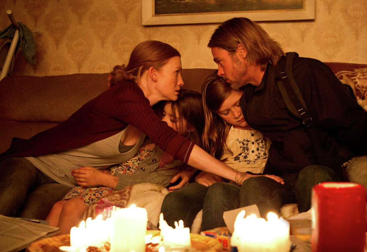 This publicity image released by Paramount Pictures shows, from left, Mireille Enos as Karin Lane, Sterling Jerins as Constance Lane, Abigail Hargrove as Rachel Lane, and Brad Pitt as Gerry Lane in a scene from