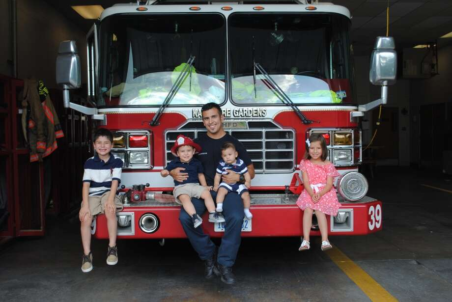 My husband Roland is the hottest Dad I know! He works so hard sometimes 96 hours a week for the Houston Fire Department. He's not only a hero to Houston he is our personal hero at home. He gives up sleep and personal time so that I can be home with our kids. He finds the time to make it to all the kids school and sport functions. He can change diapers like a champ and grill some amazing fajitas. He can do it all. We love this man to the moon and back.