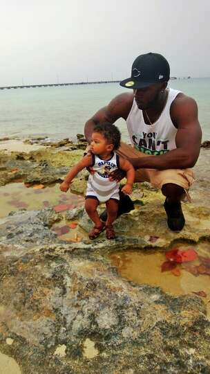 My brother Zephaniah and his 7 month old, Samson, enjoying Samson's first vacation to the U.S. Virgi