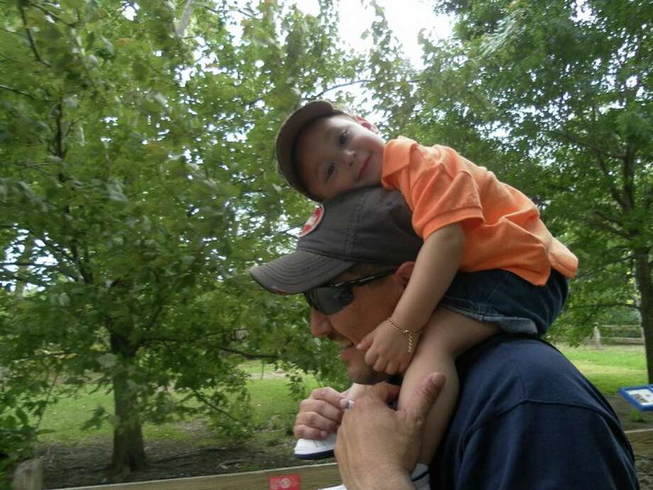 Mikey taking a break with Daddy (Mike Meza). Tired from a day at the Houston Zoo.