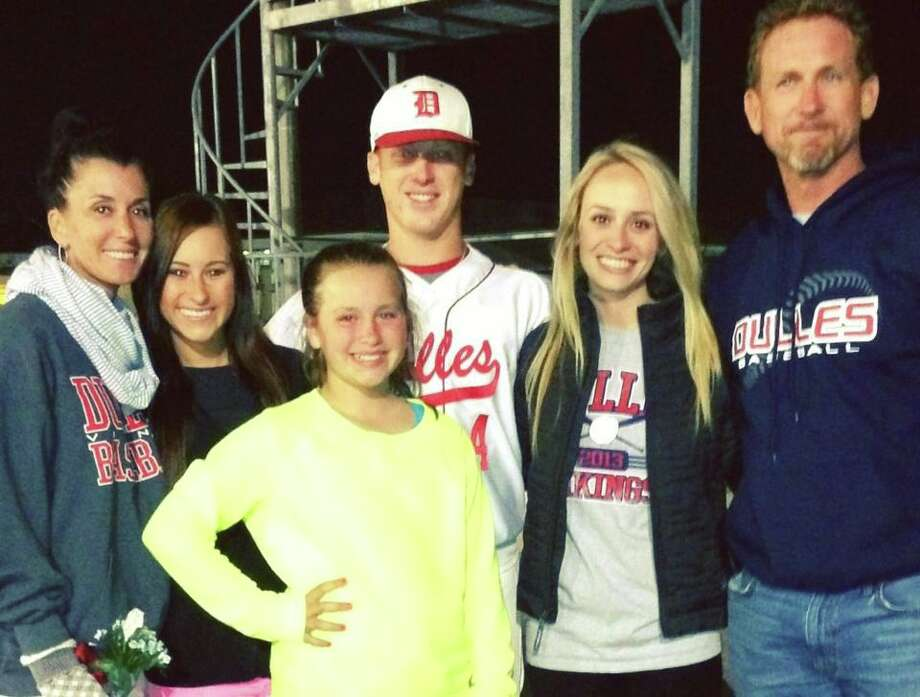 The dad is Woody Williams, who's son Caden, plays HS baseball with my son. The love this family has for each other and everyone around them is amazing. We call the family Caden's Crew, they are at every game. They are LOUD & PROUD.  L to R - Kim, Hannah, Lily, Caden, Katelyn, and Woody.