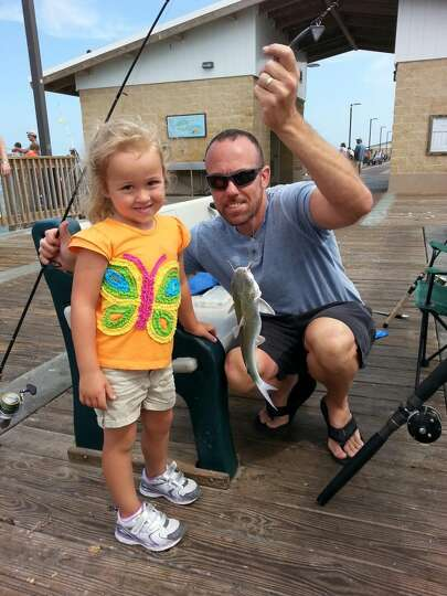 My husband, James, is the best dad to our 4 year old daughter (pictured with her first fish) and our