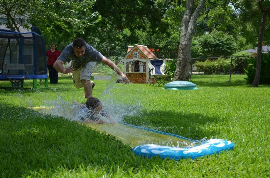 My husband is the hottest dad. Because - ultimate slip n' slide.