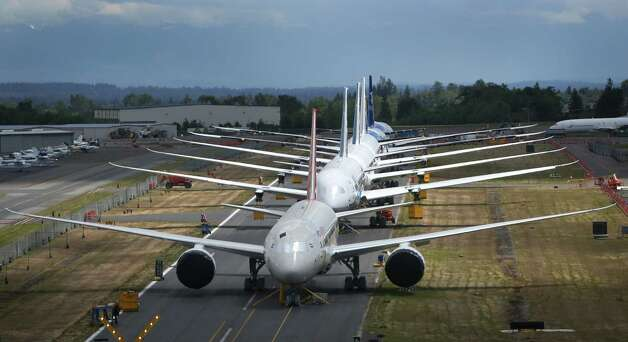 A line of Boeing 787 Dreamliners are shown on a closed runway on Tuesday, June 18, 2013 at Paine Field near Boeing's Everett assembly plant. Photo: JOSHUA TRUJILLO, SEATTLEPI.COM / SEATTLEPI.COM
