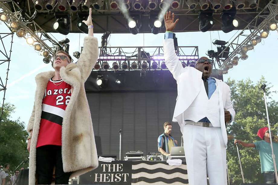 That's Macklemore in the Trailblazers jersey and lady's fur. He need only look to his left to see Wanz, who could explain to him how one should dress when planning to be outside in Houston, Texas in June.  (Photo by Gary Miller/FilmMagic) Photo: Gary Miller, Getty / 2013 Gary Miller