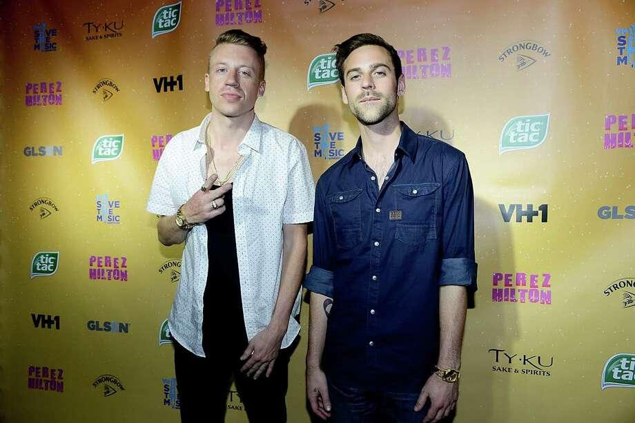 That's Ryan Lewis there, with his shirt buttoned like a grown man. Take note Professor Macklemore. Photo: Tim Mosenfelder, Getty Images / 2013 Tim Mosenfelder