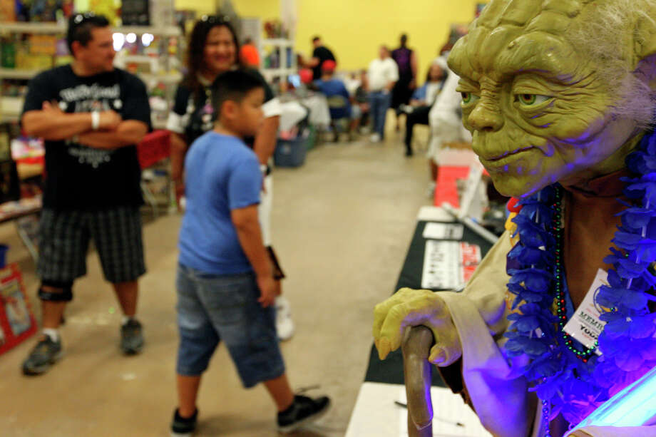 A Yoda model on display at the Star Wars Society of San Antonio booth during the Texas Comicon 2011 Sunday June 26, 2011 at the San Antonio Event Center. (PHOTO BY EDWARD A. ORNELAS/eaornelas@express-news.net) Photo: EDWARD A. ORNELAS, SAN ANTONIO EXPRESS-NEWS / © SAN ANTONIO EXPRESS-NEWS (NFS)