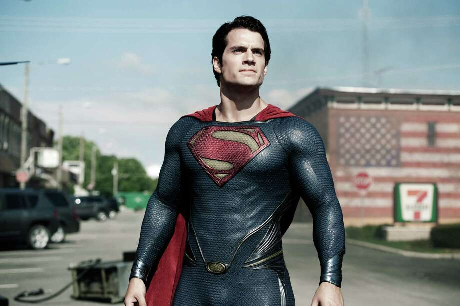 "This film publicity image released by Warner Bros. Pictures shows Henry Cavill as Superman in ""Man of Steel."" Warner Bros. enlisted Christian-focused marketing firm Grace Hill Media to promote ""Man of Steel"" to faith-based groups by inviting them to early screenings and creating trailers that highlight the film's religious themes. They also enlisted a Pepperdine University professor to create a Superman-centric sermon outline for pastors. The tale of Superman has long been associated with religious allegories. ""Man of Steel"" doesn't shy away from that theme, including portraying the character as 33 years old and having him seek counsel at a church in a time of crisis.  (AP Photo/Warner Bros. Pictures, Clay Enos) Photo: Clay Enos"