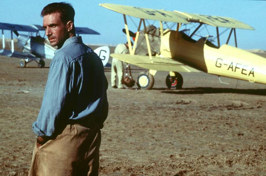"""The English Patient"" - Set against the backdrop of World War II, this Oscar-winning drama stars Ralph Fiennes as a badly burned pilot who recounts a tale of doomed romance to the nurse tending him. As his story spills out via flashback, so do secrets about his identity. Now Available Photo: PHIL BRAY, Associated Press / MIRAMAX FILMS"