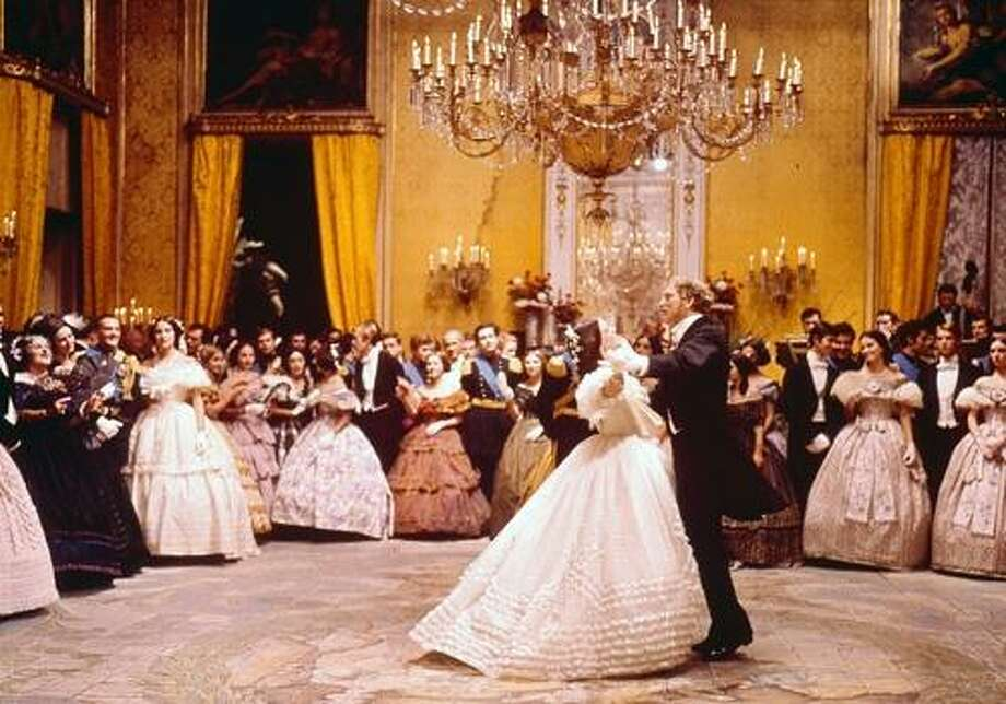 "Burt Lancaster and Claudia Cardinale go for a spin in the classic ballroom sequence of Luchino Visconti's ""The Leopard"" (1963).  Great film in the first category.  The dubbing of the actors' voices becomes a technical stumbling block that can only be overcome by an act of will. Photo: 20th Century Fox 1963"