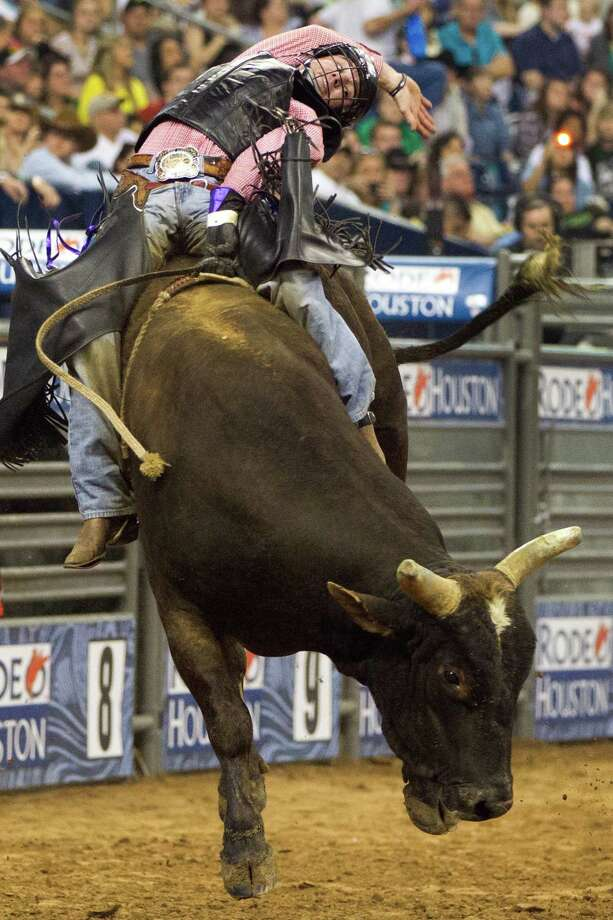 Ride a bull at the rodeo. Photo: Smiley N. Pool, Houston Chronicle / © 2012  Houston Chronicle