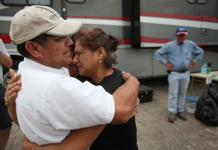 Angel Medina embraces sisters Emelinda Medina and Rosa Amelia Medina as they see eachother for the first time in the area of interest as  Texas EquuSearch volunteers, and with law enforcement from Houston Police Department, Waller County, Brookshire, and Texas Rangers search for the remains of Senovia Medina. Photo: Mayra Beltran, Houston Chronicle