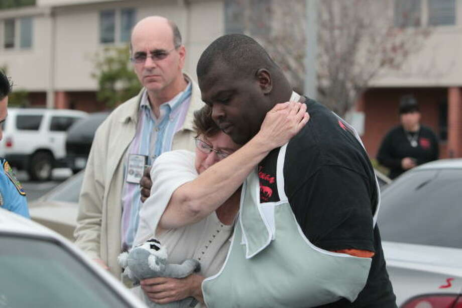 Director of Houston's Crime Victims Division Andy Kahan looks on as Mary Gifford, the grandmother of the missing 12-year-old Jonathan Foster, hugs Darryl Phillips of Texas Equusearch. Photo: Billy Smith II, Chronicle
