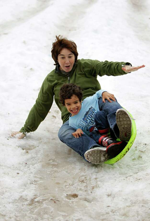 Go sledding in Discovery Green. Photo: Karen Warren, Houston Chronicle / © 2011 Houston Chronicle