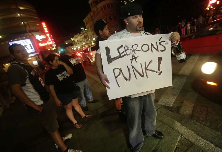 Marco Torres holds a sign as San Antonioians take to the streets downtown even after the Spurs loose to the Miami Heat in game 6 on Tuesday, June, 18, 2013.
