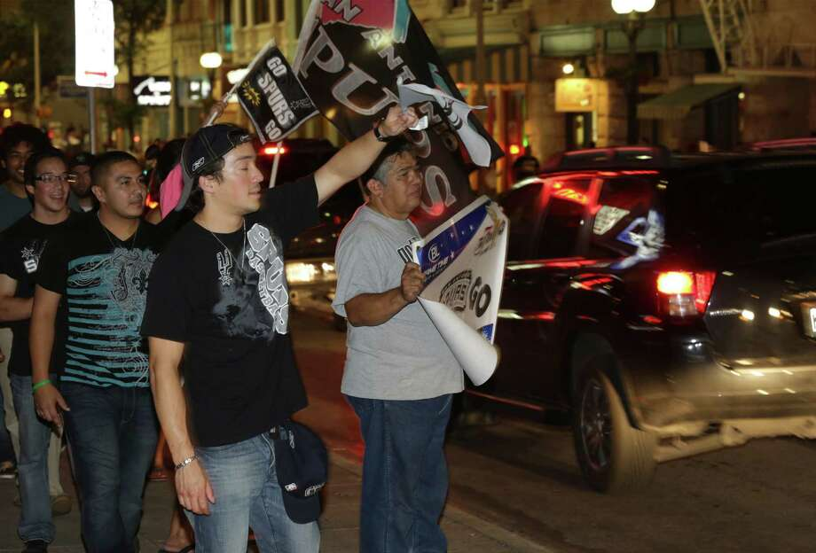 San Antonioians take to the streets downtown even after the Spurs loose to the Miami Heat in game 6 on Tuesday, June, 18, 2013. Photo: Bob Owen, San Antonio Express-News / ©2013 San Antonio Express-News