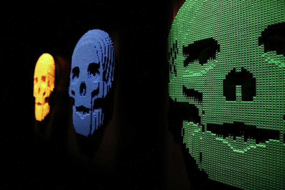 """Skulls,""  Nathan Sawaya sculptures, are displayed in the 'Art of the Brick' show at Discovery Times Square on June 18, 2013 in New York City.  Sawaya created the pieces entirely with LEGO toy bricks and the exhibition features over 100 works of art created from millions of the toy bricks. Photo: Mario Tama, Getty Images / 2013 Getty Images"