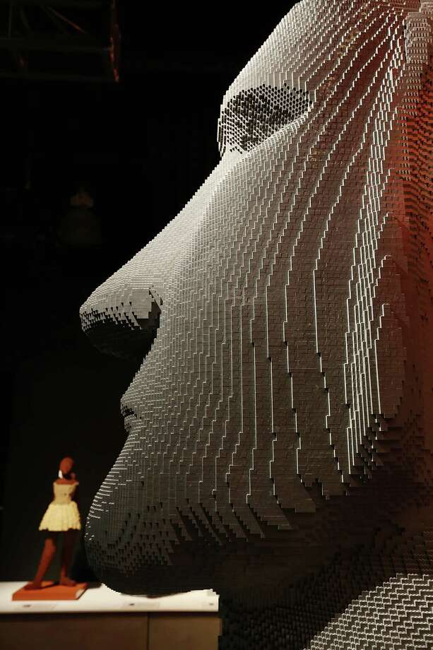 "NEW YORK, NY - JUNE 18:  ""Moai,"" a Nathan Sawaya sculpture, is displayed in the 'Art of the Brick' show at Discovery Times Square on June 18, 2013 in New York City.  Sawaya created the pieces entirely with LEGO toy bricks and the exhibition features over 100 works of art created from millions of the toy bricks. Photo: Mario Tama, Getty Images / 2013 Getty Images"
