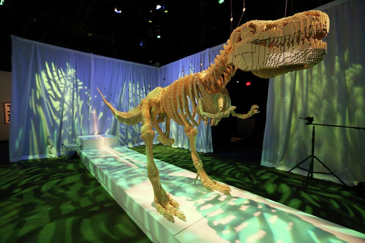 NEW YORK, NY - JUNE 18: A 20-foot T-Rex dinosaur skeleton, a Nathan Sawaya sculpture, is displayed in the 'Art of the Brick' show at Discovery Times Square on June 18, 2013 in New York City. Sawaya created the pieces entirely with LEGO toy bricks and the exhibition features over 100 works of art created from millions of the toy bricks.