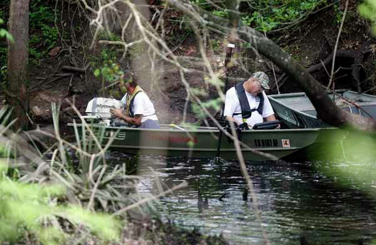 Texas Equusearch used a small boat equipped with sonar to search for 2-year-old Devin Davis in a creek near his home where he went missing yesterday afternoon while his mother was taking a nap in Liberty County east of Cleveland Wednesday, March 28, 2012, in Cleveland. The boy's mother said she had fallen asleep after securing her son and another 1-year-old child for a nap, said Rex Evans with the Liberty County Sheriff's Department. The mother told authorities that the door to the house was locked with a bolt, but somehow the child managed to get outside. She discovered him missing about 3:30 p.m. Tuesday, looked around frantically for a while and then alerted authorities who issued an Amber Alert. Evans said the mother also found the door to her jeep was ajar, though she said she had left it shut. The child was last seen wearing a red and gray T-shirt and jeans. Initially, authorities thought he was wearing Spiderman tennis shoes but those shoes were located inside the home.