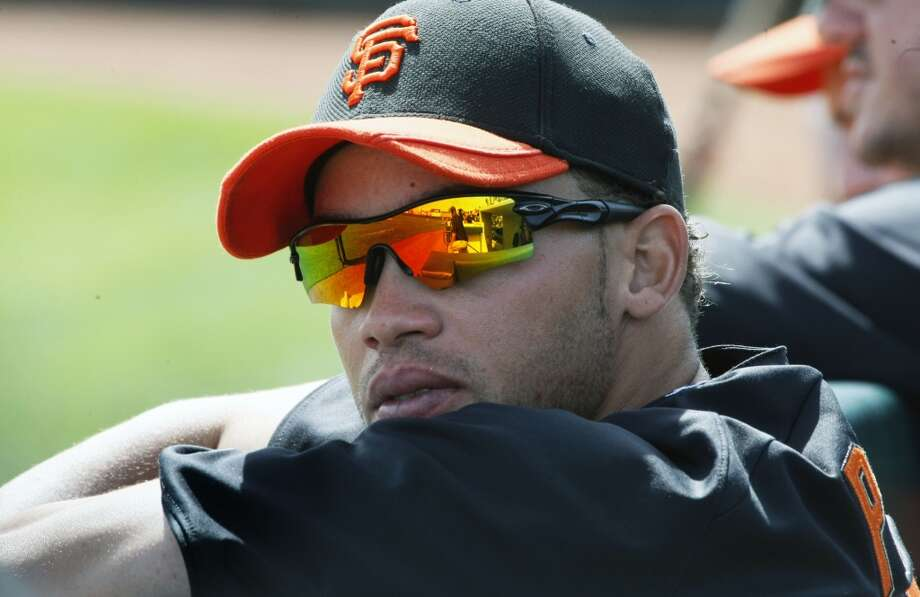 The Giants roster looks a little different lately. MVPs from the NLCS and World Series are now hoody'd spectators lining the dugout rails during games. All the team can do is wait on the culprits: Scutaro's pinky and Vogey's hand, Pablo's foot, Pagan's hammy and Casilla's knee.  But a hurt team needs help and can't wait. Newly called up this month are a bunch of rookies, near-rookies and other unproven talent mostly unknown to fans. Some are future prospects making early debuts; others are longtime minors players hoping for a chance to stick in the big leagues.  Whoever they are, they could factor big in the Giants performance over the next month. Whether they prove to be Band-Aids or long term additions, it's worth taking some time to get to know our latest batch of callups.