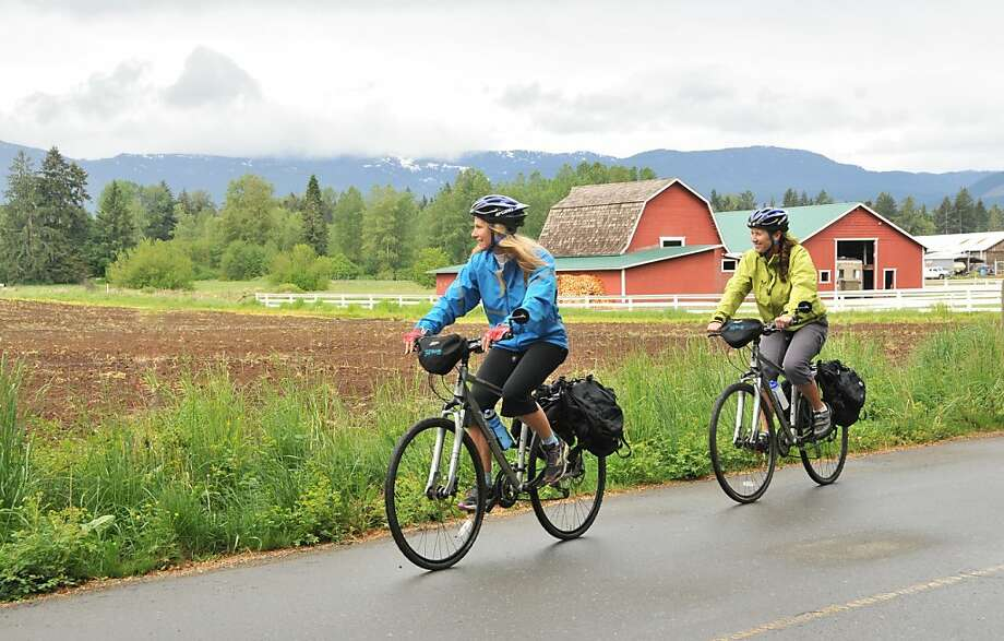 Laurel Kronk (top left) and Kim Barry of Island Joy Rides guide a tour through fertile Comox Valley on Vancouver Island. Photo: Margo Pfeiff, Special To The Chronicle