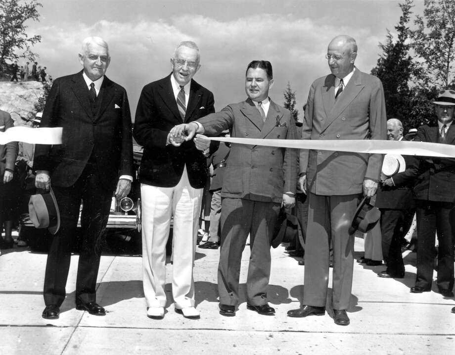 In early summer of 1938, Former Congressman Schuyler Merritt of Stamford, in the white pants, was on hand to assist Greenwich First Selectman Eugene S. Loughlin, to his right, at the ribbon-cutting ceremony to open the Merritt Parkway in Greenwich. Photo: Contributed Photo, ST / Greenwich Citizen
