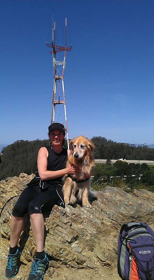 Meredith May atop Twin Peaks with her hiking partner, Stella. Photo: Jaime Amaya
