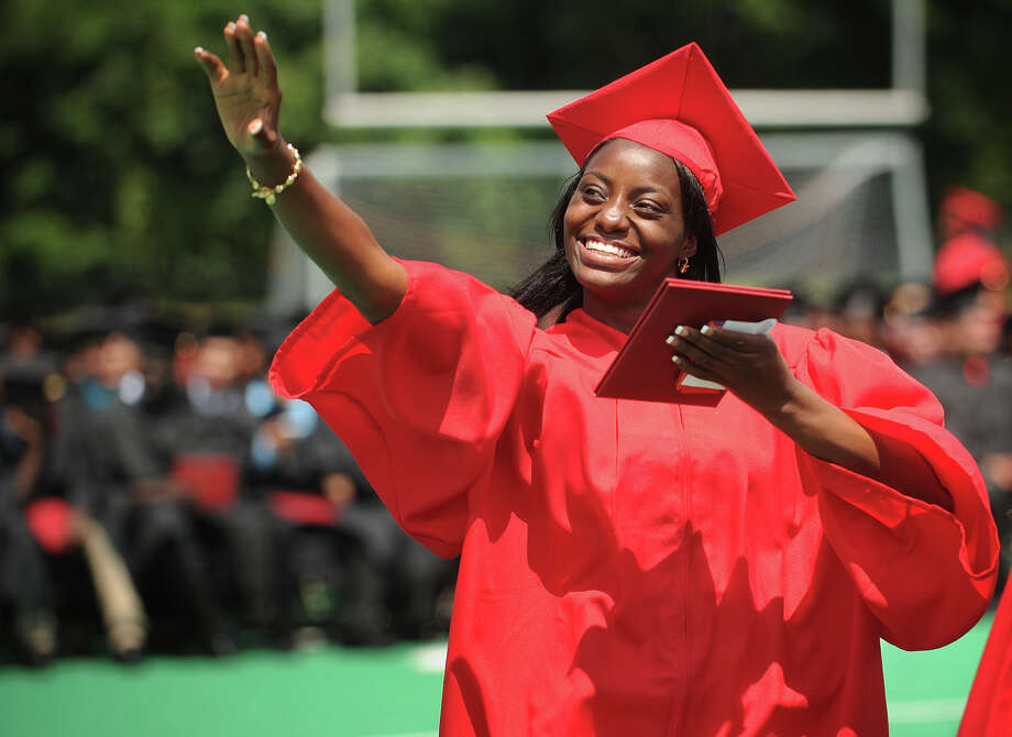 Shannel Ewers waves to family after receiving her diploma at the Central High School graduation at Kennedy Stadium in Bridgeport, Conn. on Wednesday, June 19, 2013. Photo: Brian A. Pounds / Connecticut Post