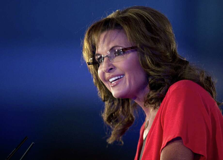 Sarah Palin (shown speaking at the Faith and Freedom Coalition Road to Majority 2013 conference) uses her fertility as a trump political card. Photo: Carolyn Kaster, Associated Press