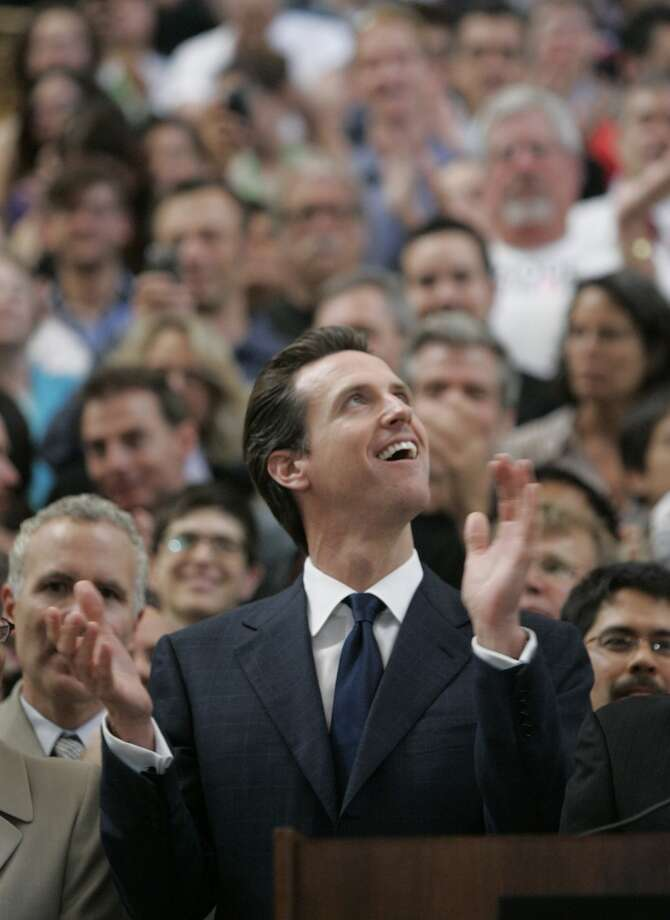 May 15, 2008: The California Supreme Court overturns the same-sex marriage ban on a 4-3 vote. San Francisco Mayor Gavin Newsom applauds the verdict during a rally inside City Hall in San Francisco.