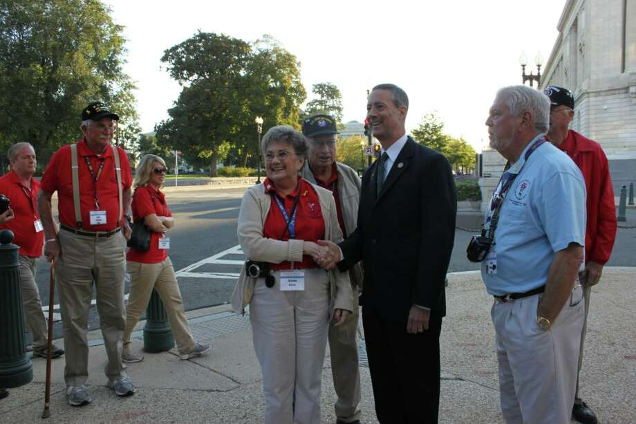 Rep. Mac Thornberry visiting with members of the Texas Panhandle Honor Flight in September 2012.
