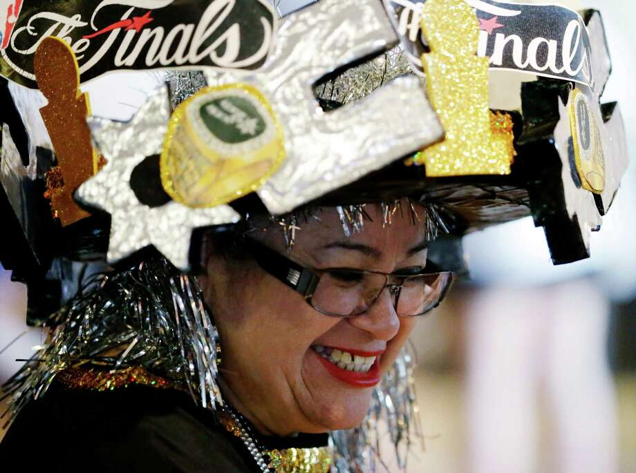 San Antonio Spurs fan Savia Lauriano arrives for Game 5 of the NBA Finals basketball series against the Miami Heat, Sunday, June 16, 2013, in San Antonio. (AP Photo/David J. Phillip) Photo: David J. Phillip, Associated Press / AP