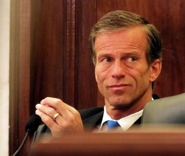 South Dakota Republican Sen. Jon Thune probes panel experts at the Commerce Committee hearing on rai
