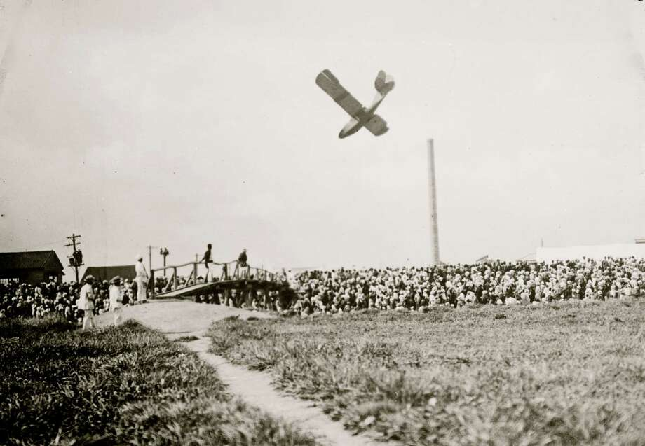 Mishaps also have been part of air shows since the beginning. Here's a view of an unidentified plane seemingly about to crash during an early air show. Photo: Buyenlarge, Getty Images / Archive Photos