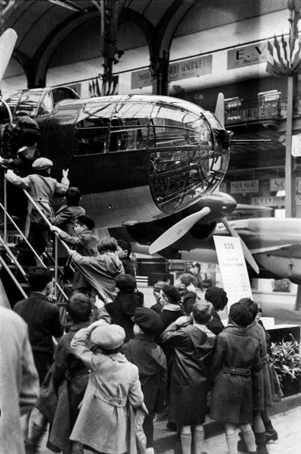 Visitors check out a French Block 136 bomber during an air show at the Grand Palais in Paris on November 26, 1938. Photo: Gamma-Keystone Via Getty Images