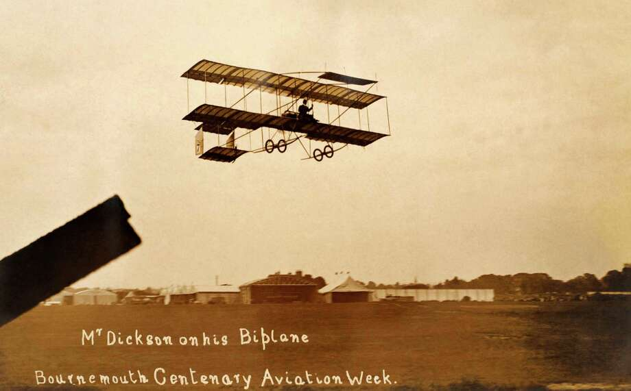 A vintage postcard photograph shows aviator Bertram Dickson flying his biplane during the Bournemouth, England, Centenary Aviation Week, circa 1909.  A year later he was involved in the world's first mid-air collision during an air meet in Milan, Italy. Dickson survived, but injuries contributed to his death in 1913. Photo: Popperfoto, Popperfoto/Getty Images