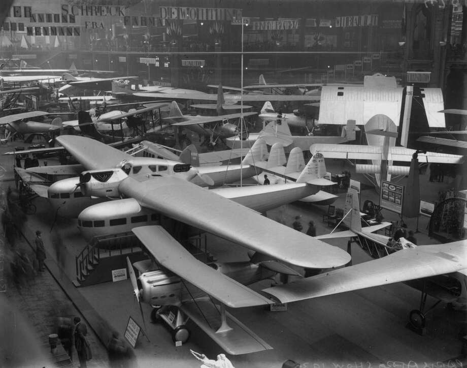 A Bleriot XII nestles under a Bleriot 125 on the Bleriot stand at the 1930 Paris Air Show. Foreground shows a SPAD 91 biplane. Photo: Central Press, Getty Images / Hulton Archive