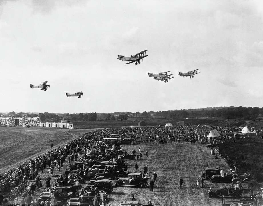 Day bombers fly over spectators at Hendon, England, during a U.K. Royal Air Force exhibition in 1926. Photo: Topical Press Agency, Getty Images / Hulton Archive