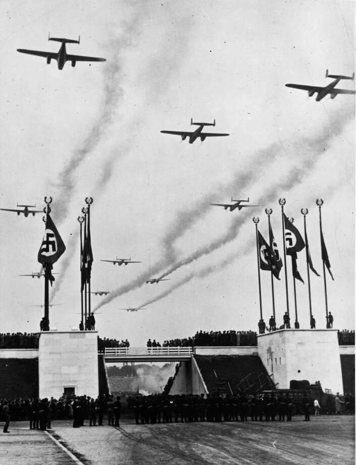 German Luftwaffe bombers leave a smoke trail as they fly over a Nuremberg rally in September 1938. Photo: Max Schirner, Getty Images / Hulton Archive